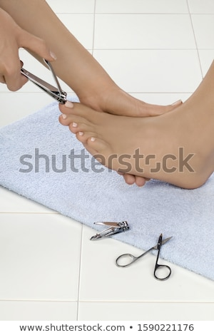 side view of a young woman receiving pedicure treatment stock photo © wavebreak_media