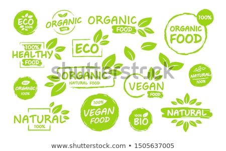 100 percent organic food and natural product with leaf signs in  Stock photo © marinini
