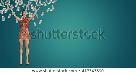 Asian Woman Catching Money Falling From The Sky Foto stock © kentoh
