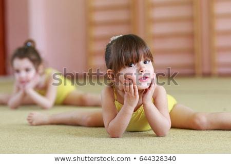 criança · comprometido · ginástica · isolado · branco · pequeno - foto stock © fanfo