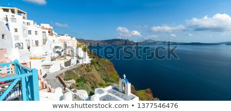view on windmill and aegean sea from therasia island santorini greece stock photo © photocreo