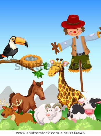 many wild animals and scarecrow in thefield stock photo © bluering