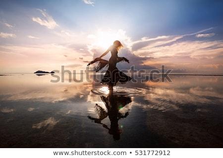 beautiful women dancing silhouettes stock photo © krisdog