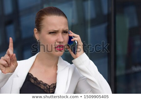 Preocupado empresária desagradável telefone conversa telefone móvel Foto stock © stevanovicigor