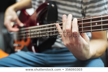 male hand playing bass guitar Stock photo © meinzahn