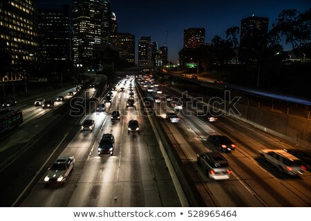 Stock photo: Evening/Night City car traffic - cars on a city road polluting
