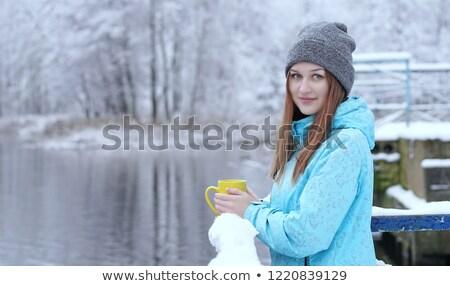 Belo mulher jovem mão amarelo copo Foto stock © Massonforstock