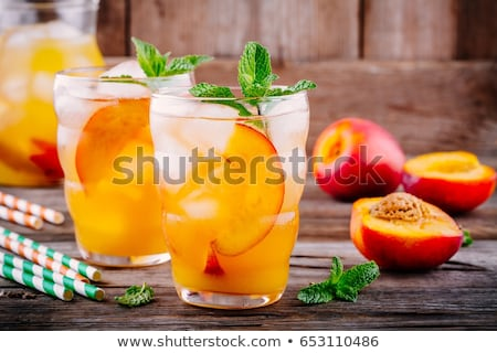 homemade lemonade with ripe peaches and fresh mint fresh peach stock photo © yatsenko