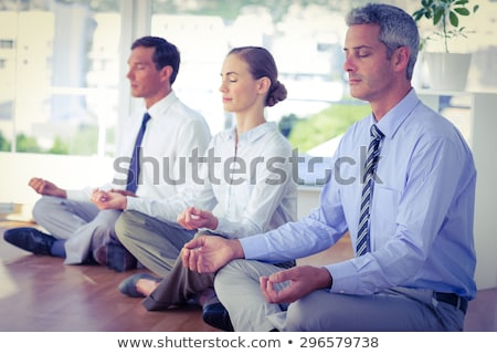 peaceful business woman doing yoga stock photo © rastudio