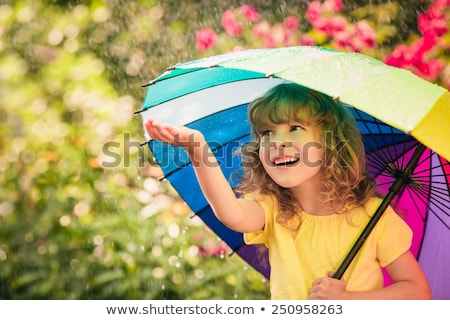 smiling girl with umbrella stock photo © aikon
