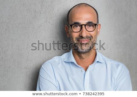 Portret volwassen man echt zwarte muur man Stockfoto © filipw