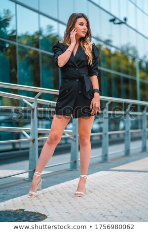Portrait of young woman looking far away through the glass Stock photo © chesterf