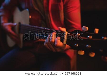 Mid section of guitarist playing guitar at nightclub Stock photo © wavebreak_media