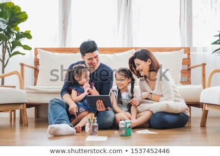 отец дочь используя ноутбук цифровой таблетка кровать Сток-фото © wavebreak_media