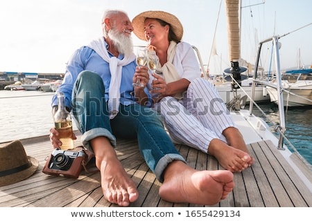 Couple on sailboat, face to face Stock photo © IS2