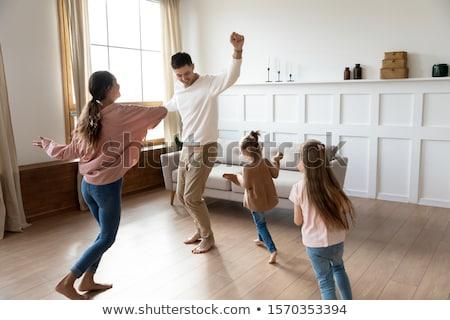 Famiglia dancing uomo bambino Coppia madre Foto d'archivio © IS2