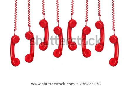 Hanging phone isolated on white Stock photo © klikk