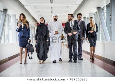 Közel-keleti férfi nő kaukázusi beszél iroda Stock fotó © monkey_business