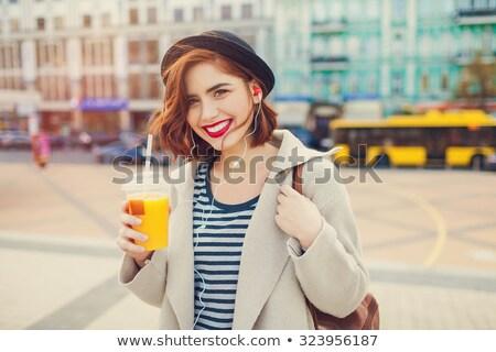 Stockfoto: Gelukkig · jonge · dame · hoofdtelefoon · drinken · sap
