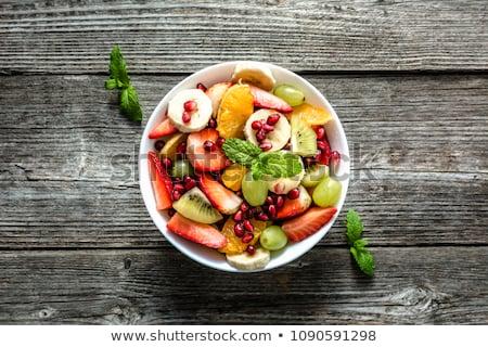 Tál frissítő gyümölcssaláta közelkép nyári gyümölcs saláta Stock fotó © mpessaris