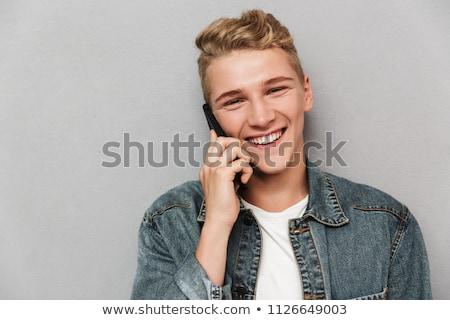 Teenage boy talking on cellular telephone Stock photo © IS2