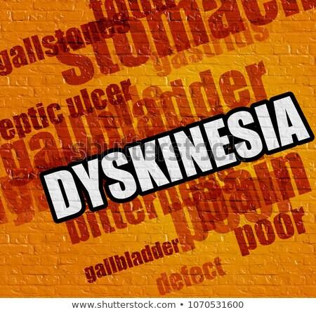 health concept dyskinesia on the yellow wall stock photo © tashatuvango