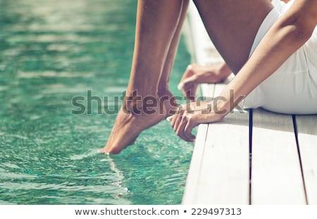 ног край бассейна женщину путешествия острове Сток-фото © IS2