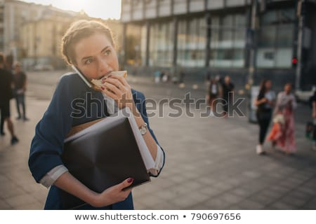 Businesswoman having a snack Stock photo © IS2