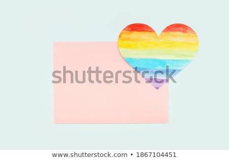 man with a rainbow flag in a piece of paper Stock photo © nito