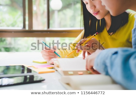 young woman teacher shares knowledge with students stock photo © vectorikart