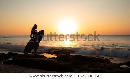 Mujer surfista puesta de sol bali caminando playa Foto stock © joyr