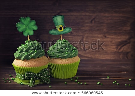 green cupcakes and st patricks day decorations stock photo © dolgachov