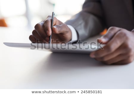 portrait of relaxed and joyful businessman looking at tablet stock photo © feedough