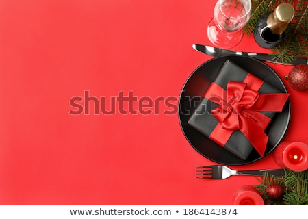 Stock photo: Christmas table setting with champagne and xmas gift