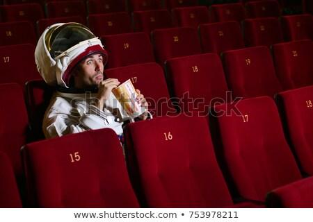 Woman astronaut eats in a spaceship Stock photo © studiostoks