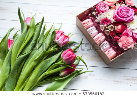 Foto stock: Red Tulip Flowers And Macaroon Cookies