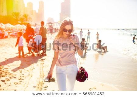 Retrato sedutor loiro senhora mulher flor Foto stock © konradbak