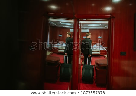 Businessman standing with door on his back Stock photo © ra2studio