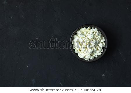 Ev yapımı süzme peynir siyah seramik çanak karanlık Stok fotoğraf © artsvitlyna