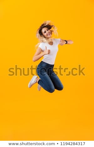 Full length photo of positive blond woman in basic clothing jump Stock photo © deandrobot