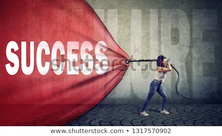 motivated woman pulling a red banner with success word overcoming a failure stock photo © ichiosea