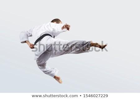 Felnőtt sportoló rúg ugrás férfi sport Stock fotó © Andreyfire