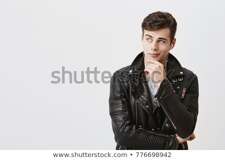 attractive man in leather jacket with finger on his chin  Stock photo © feedough