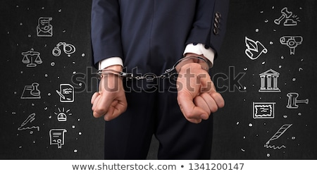 Symbols of courthouse with handcuffed man Stock photo © ra2studio