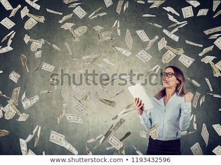 Successful young woman using tablet computer building online business earning money Stock photo © ichiosea