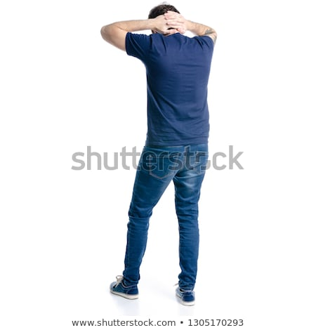 attractive man smiling and holding a hand behind his neck stock photo © feedough
