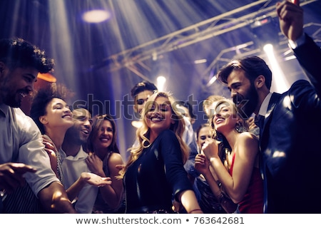 christmas party dancing friends celebrating holiday stock photo © robuart