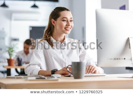 Feliz camisa sesión lugar de trabajo oficina Foto stock © deandrobot