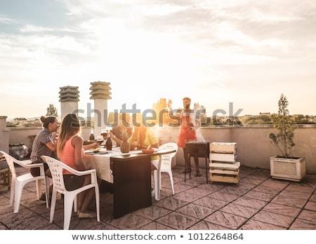 mosolyog · emberek · beszélnek · iszik · sör · asztal · kint - stock fotó © dolgachov