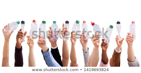 People Holding Crushed Water Bottles In White Background Stock photo © AndreyPopov